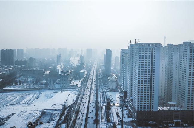 迎春雪景美如画 高原古城亮素颜